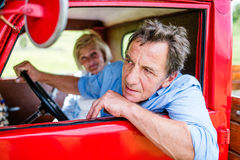 Senior couple in red car Royalty Free Stock Photo