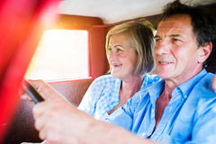 Senior couple in red car Stock Photography