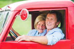 Senior couple in red car Royalty Free Stock Photography