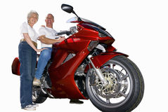 Senior couple with red motorcycle, cut out Stock Images