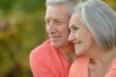 Senior couple relax in autumn park Royalty Free Stock Photo