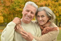 Senior couple relax in autumn park Royalty Free Stock Images