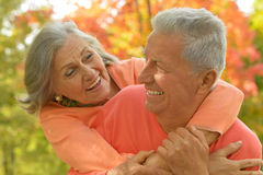 Senior couple relax in autumn park Stock Photography