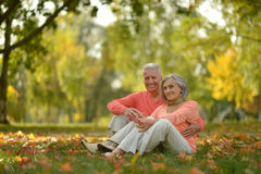 Senior couple relax in autumn park Stock Photo