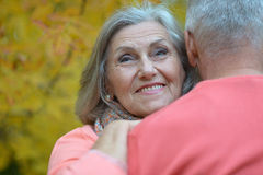 Senior couple relax in autumn park Stock Photos