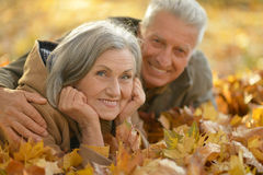 Senior couple relax in autumn park Royalty Free Stock Photography