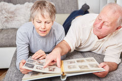 Senior couple in relaxation. Holding photo album Stock Photography