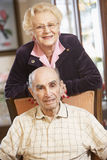 Senior couple relaxing in armchairs Royalty Free Stock Images