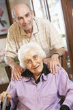 Senior couple relaxing in armchairs royalty free stock photo