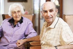 Senior couple relaxing in armchairs Royalty Free Stock Image