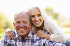 Senior Couple Relaxing In Autumn Landscape royalty free stock image