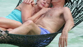 Senior Couple Relaxing In Beach Hammock stock video footage
