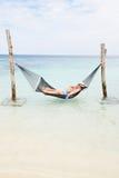 Senior Couple Relaxing In Beach Hammock Royalty Free Stock Photos