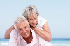 Senior Couple Relaxing On Beach Holiday Royalty Free Stock Image