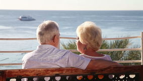 Senior couple relaxing on the bench stock footage