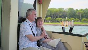 Senior Couple Relaxing On Boat Journey. Senior couple relazing anj enjoying a view on a boat trip. Old woman and man hugging. Male and female travelers exploring stock footage