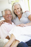 Senior Couple Relaxing In Chair At Home Stock Images