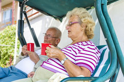 Senior Couple relaxing and drinking coffee Stock Photo