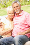 Senior Couple Relaxing In Garden Stock Photography