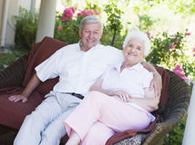 Senior couple relaxing on garden seat Royalty Free Stock Images
