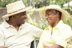 Senior Couple Relaxing In Garden Together Stock Photos