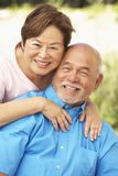 Senior Couple Relaxing In Garden Together Stock Image