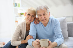 Senior couple relaxing at home drinking tea Stock Photography