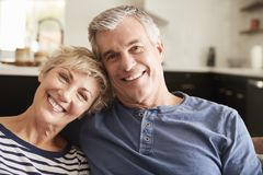 Senior couple relaxing at home smiling to camera, close up stock photos