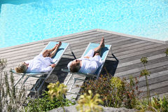Senior couple relaxing in luxury resort Stock Image