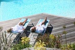 Senior couple relaxing in luxury resort Stock Image
