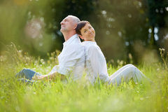 Senior couple relaxing in nature Royalty Free Stock Image