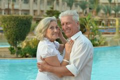 Senior couple relaxing near pool Royalty Free Stock Images