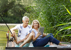 Senior couple relaxing outdoor Royalty Free Stock Image