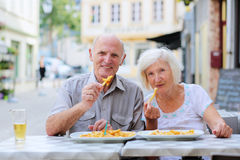 Senior couple relaxing on outdoors cafe Stock Images