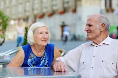 Senior couple relaxing on outdoors cafe Stock Photos