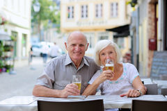 Senior couple relaxing on outdoors cafe Stock Photography