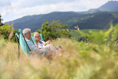 Senior couple relaxing outdoors on holidays Stock Photography