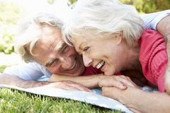 Senior Couple Relaxing In Park Together Royalty Free Stock Photography