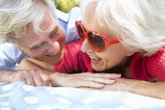 Senior Couple Relaxing In Park Together Royalty Free Stock Images