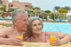 Senior couple relaxing in  pool Royalty Free Stock Photography