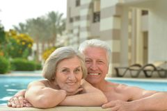 Senior couple relaxing at pool Stock Photos