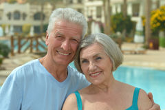Senior couple relaxing at pool Royalty Free Stock Images