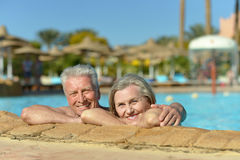 Senior couple relaxing at pool Stock Photo