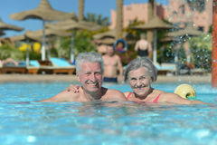 Senior couple relaxing at pool Royalty Free Stock Image