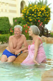 Senior couple relaxing at pool Royalty Free Stock Photography
