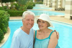 Senior couple relaxing at pool Royalty Free Stock Photo