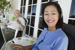 Senior couple relaxing on porch Royalty Free Stock Image
