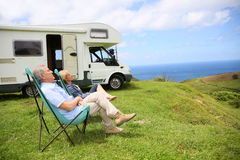 Senior couple relaxing on the seaside Royalty Free Stock Photo