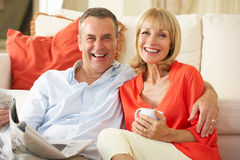 Senior Couple Relaxing On Sofa Royalty Free Stock Image