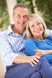 Senior Couple Relaxing On Sofa At Home Royalty Free Stock Photos